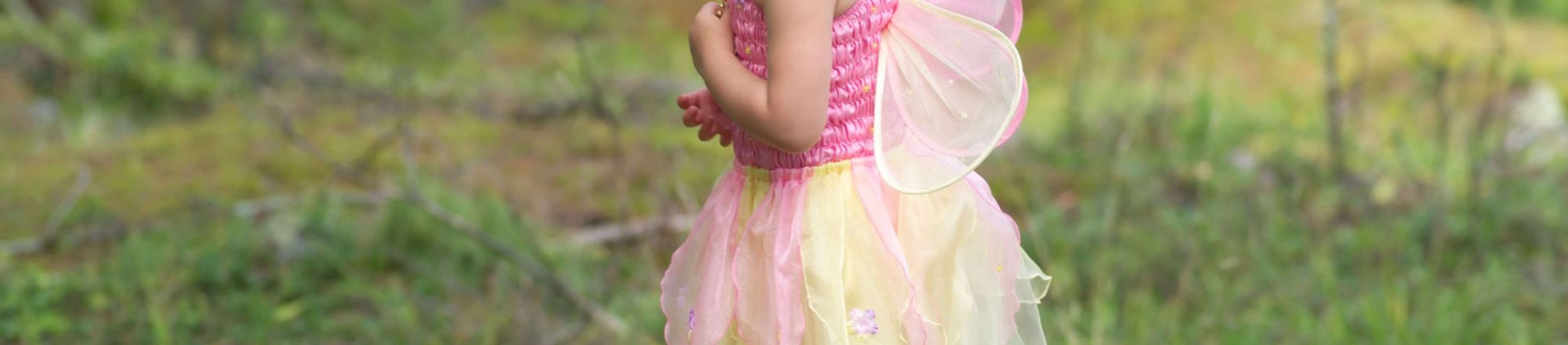 Girl in fairy outfit in forest