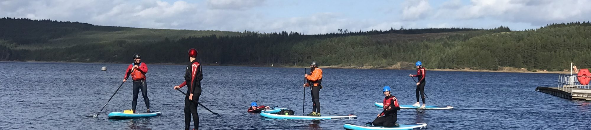 Group of adults paddle boarding